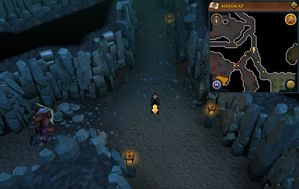 Scan clue Taverley Dungeon in passage north-west of magic axe chamber.png
