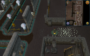 Scan clue Dorgesh-Kaan upper level east, outside large rectangular empty building.png