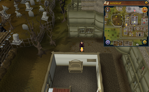 Scan clue West Ardougne between chapel and graveyard.png