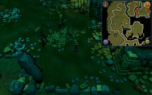 Scan clue Brimhaven Dungeon lower level in west chamber with staircase to upper level.png
