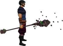 Earth battlestaff equipped.png: Earth battlestaff equipped by a player