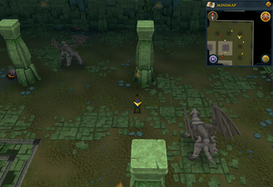 Scan clue Brimhaven Dungeon lower level north-east corner of the chamber containing iron and steel dragons.png