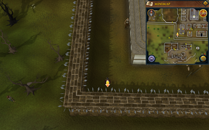 Scan clue West Ardougne in corner south of graveyard.png