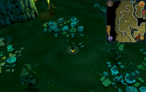Scan clue Brimhaven Dungeon lower level in the centre of the Moss Giants chamber.png